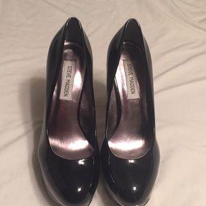 Platform black and metallic embellished high heels